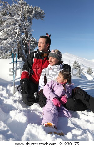 Portrait of a family on a skiing holiday together - stock photo
