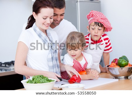 Portrait of a family preparing a meal in a kitchen