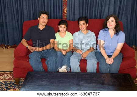 Portrait of a family sitting on a couch
