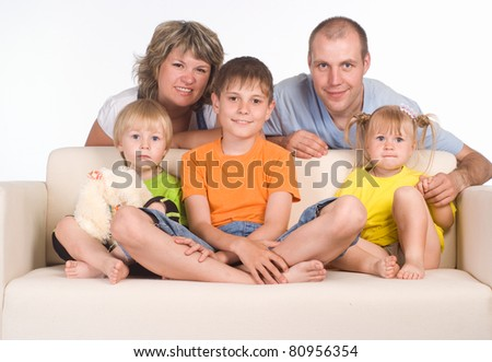 portrait of a family sitting on sofa