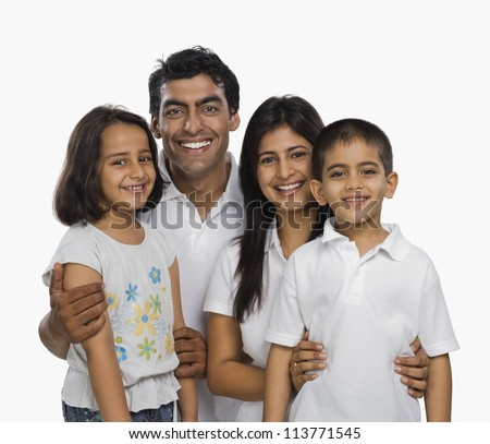 Portrait of a family smiling - stock photo