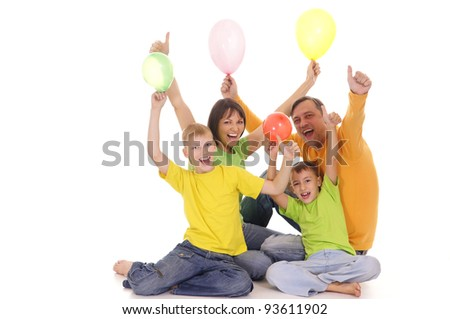 portrait of a family with baloons on white