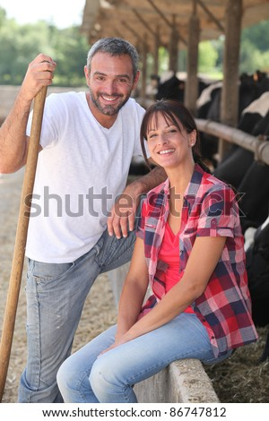Portrait of a farmer and his wife - stock photo