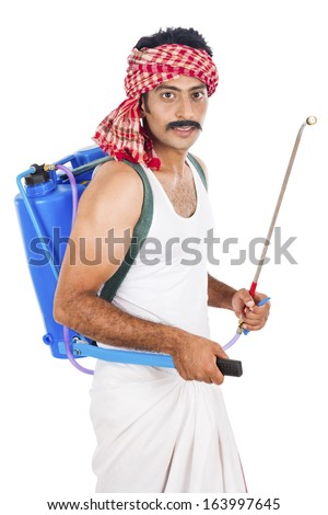 Portrait of a farmer carrying crop sprayer - stock photo
