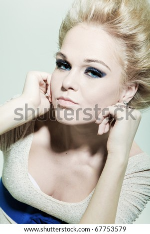 Portrait of a fashion blond with smoky eyes - stock photo