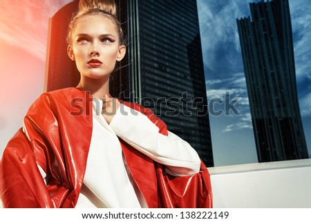Portrait of a fashion model posing over big city background.