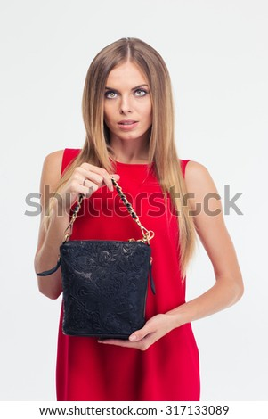 Portrait of a fashion woman in red dress holding bag isolated on a white background