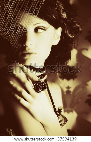 Portrait of a fashionable lady over vintage background. - stock photo