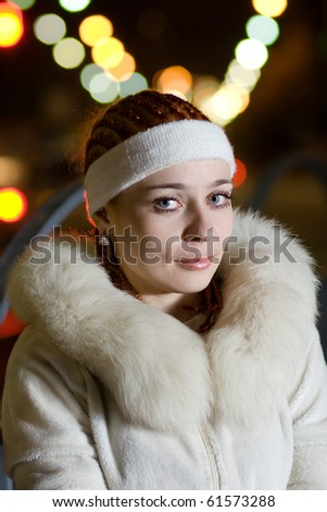 Portrait of a fashionable teenage girl outdoors at night - stock photo