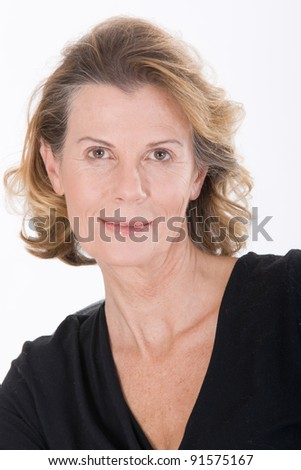Portrait of a fashionably-dressed older woman /Portrait of an elderly woman - stock photo