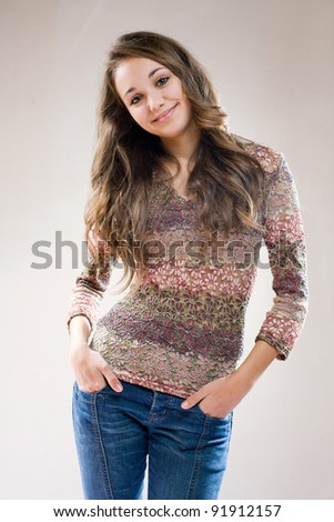 Portrait of a fashionalble beautiful young friendly brunette. - stock photo