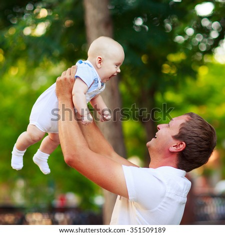 Portrait of a father and baby outdoors
