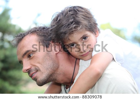 Portrait of a father and his son - stock photo