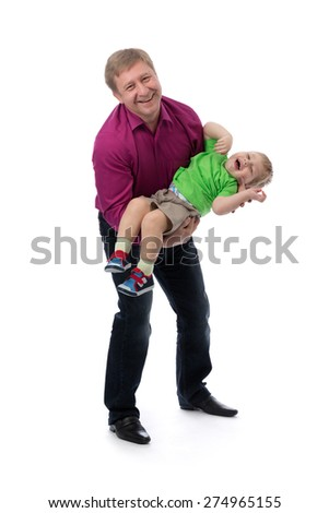 Portrait of a father and three year old son in her arms in the studio. Isolate on white. - stock photo
