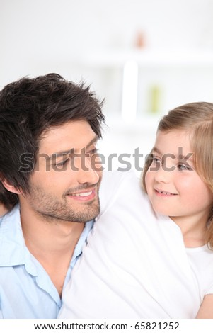 Portrait of a father smiling to his daughter
