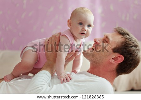 Portrait of a father with his baby daughter - stock photo