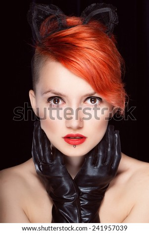Portrait of a female cat with red hair with red lipstick haircut, - stock photo