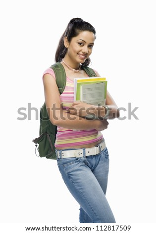Portrait of a female college student holding files - stock photo