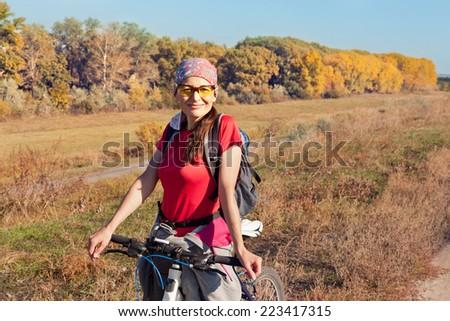 Portrait of a female cyclist - stock photo