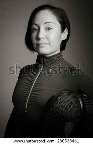 Portrait of a female fencer wearing fencing uniform and holding  - stock photo
