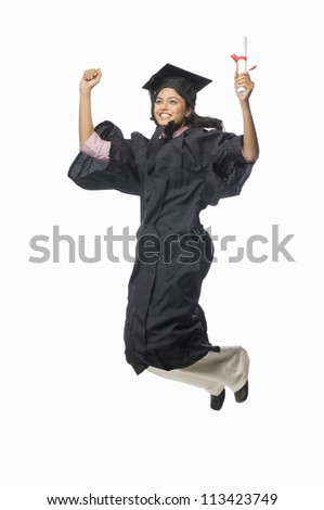 Portrait of a female graduate cheering with her diploma - stock photo