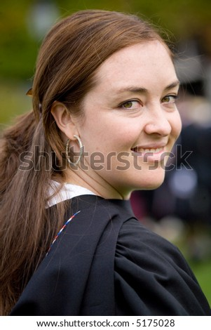 portrait of a female graduating at university - stock photo