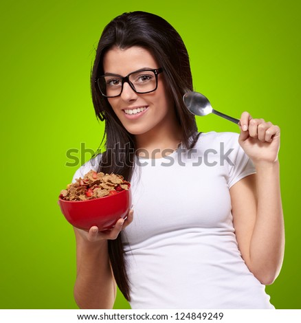 Portrait Of A Female Holding A Breakfast Bowl On Green Background
