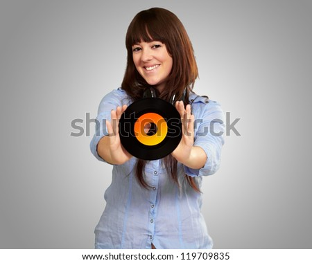 Portrait Of A Female Holding A Disc On A Grey Background
