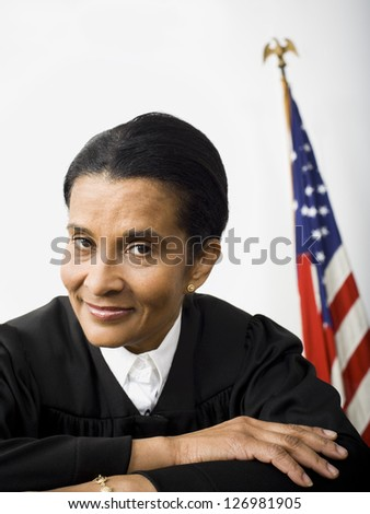 Portrait of a female judge smiling - stock photo