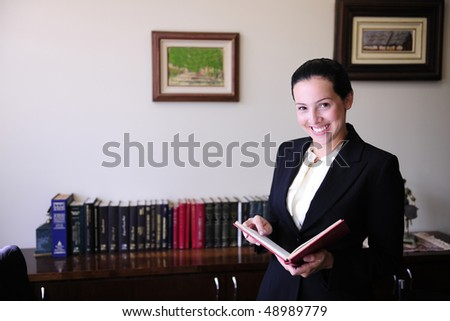 portrait of a female lawyer at office Remark for editors: Pictures on the wall were changed on Photoshop (no property release necessary) - stock photo