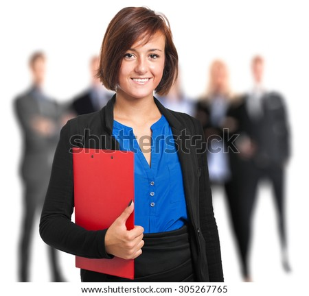 Portrait of a female manager in front of her team - stock photo