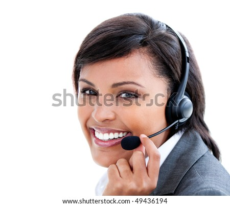 Portrait of a female manager with headset on against a white background - stock photo