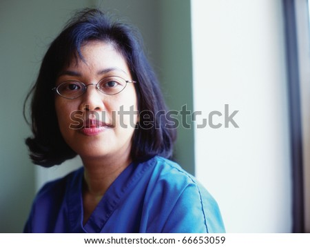 Portrait of a female nurse smiling - stock photo