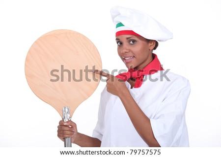portrait of a female pizza chef - stock photo