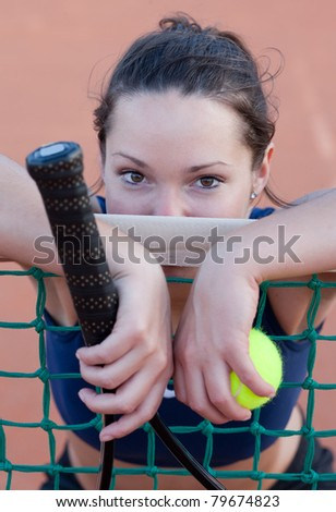Portrait of a female tennis player - stock photo