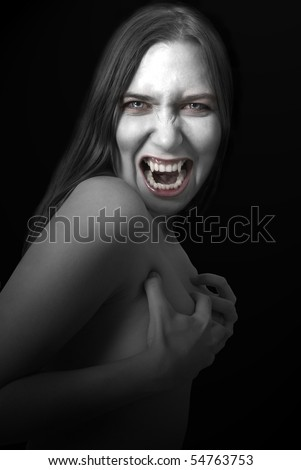 Portrait of a female vampire on black background.