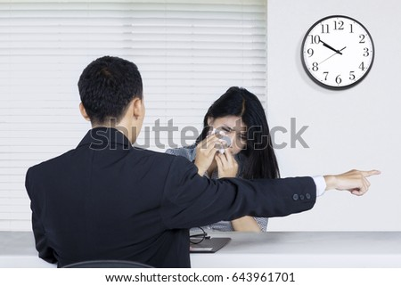 Portrait of a female worker fired by a male entrepreneur in the office room
