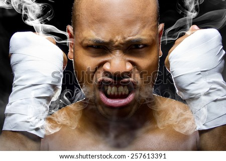 portrait of a fighter who is smoking or steaming from intensity - stock photo