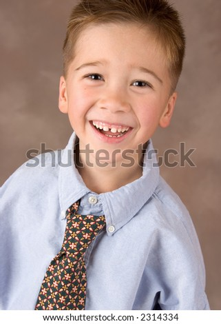 Portrait of a Filipino Boy Dressed up in Adult Business Clothes - stock photo