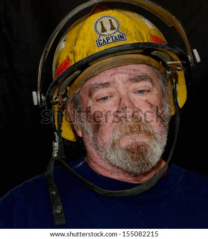 Portrait Of A  Fire Captain With A Solemn Expression - stock photo