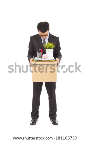 portrait of a fired businessman carrying a box - stock photo
