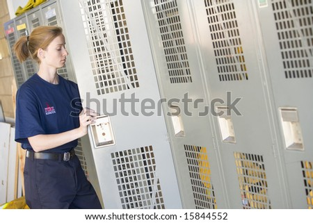 Portrait of a firefighter in the fire station locker room - stock photo