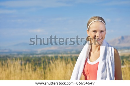 Portrait of a fit and healthy woman (with copy space) - stock photo