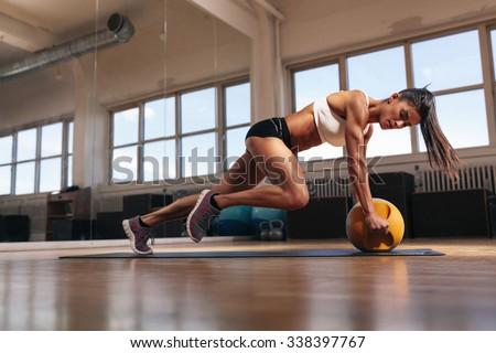 portrait fit muscular woman doing intense stock photo
