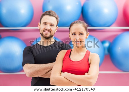Portrait of a fit couple in a gym. Slective focus on the woman with braces.