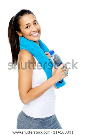 portrait of a fit healthy woman with gym towel and water bottle isolated on white background - stock photo
