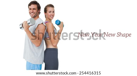 Portrait of a fit young couple exercising with dumbbell over white background - stock photo