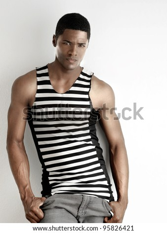 Portrait of a fit young male fashion model against white background - stock photo