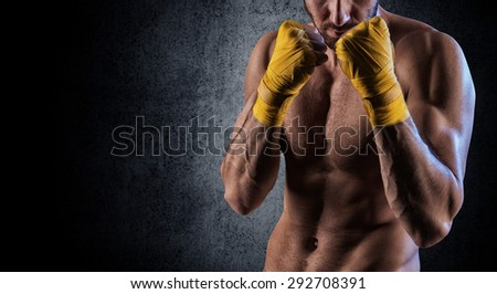 Portrait of a fit young man in an aggressive pose with raised arms  - stock photo