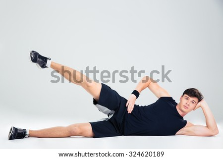 Portrait of a fitness man doing yoga exercises isolated on a white background
